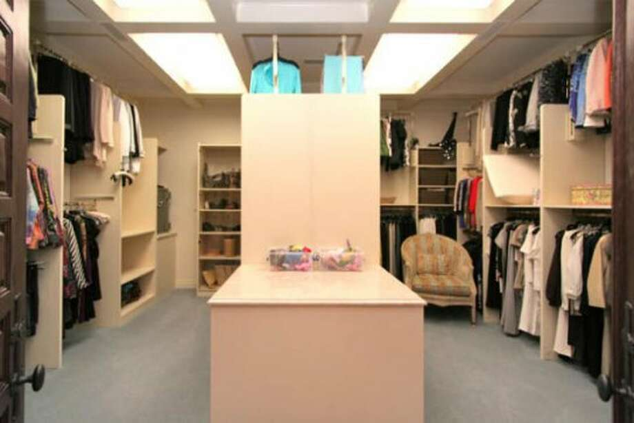 This and the other master suite walk-in closet were designed by Randy Martin to provide a plethora of space for wardrobe storage.