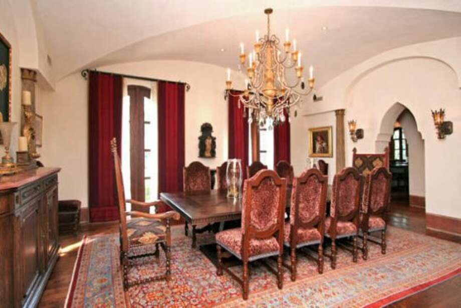 The stately, formal dining room is a perfect setting for dinners with the family or guests.