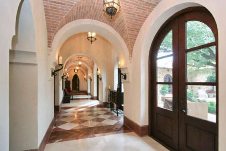 This long hallway, with its elegantly arched ceilings, offers a wonderful view into one of the estate's four courtyards.