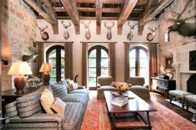 A living room lined with mounted deer trophies is a paradise for big game hunters and enthusiasts alike.