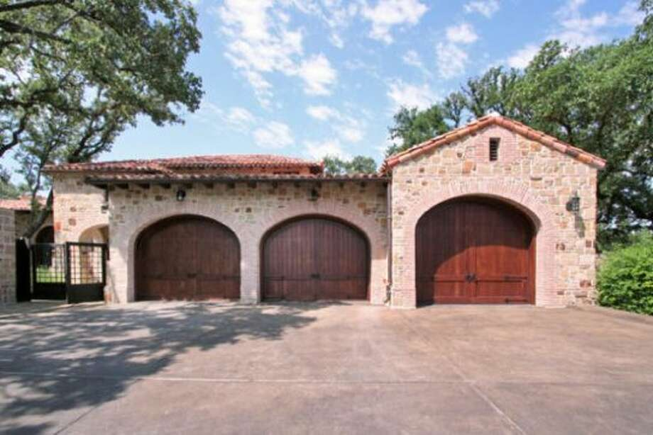 At this home, even the garage doors, which are made of mahogany, are stylish.