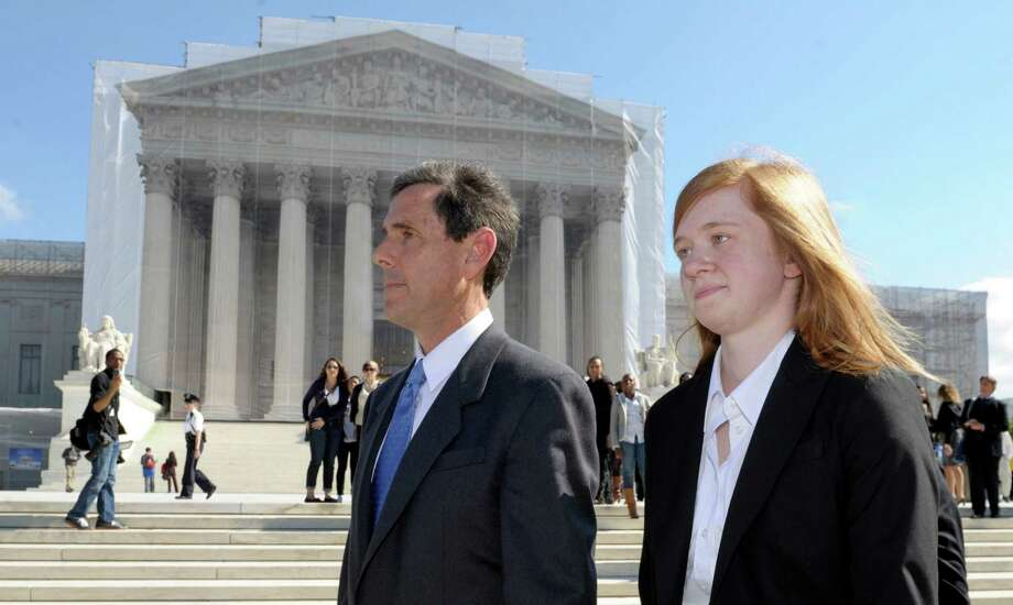 Abigail Fisher, the Texan involved in the University of Texas affirmative action case, and Edward Blum, who runs a group working to end affirmative action, walks outside the Supreme Court in Washington, Wednesday, Oct. 10, 2012. The Supreme Court is taking up a challenge to a University of Texas program that considers race in some college admissions. The case could produce new limits on affirmative action at universities, or roll it back entirely. (AP Photo/Susan Walsh) Photo: Susan Walsh, Associated Press / AP