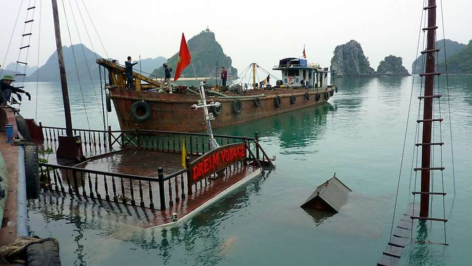 A submerged tour boat is raised last year from Halong Bay, where five died in a collision Oct. 3. Photo: Dinh Tran Trung Hau, Associated Press