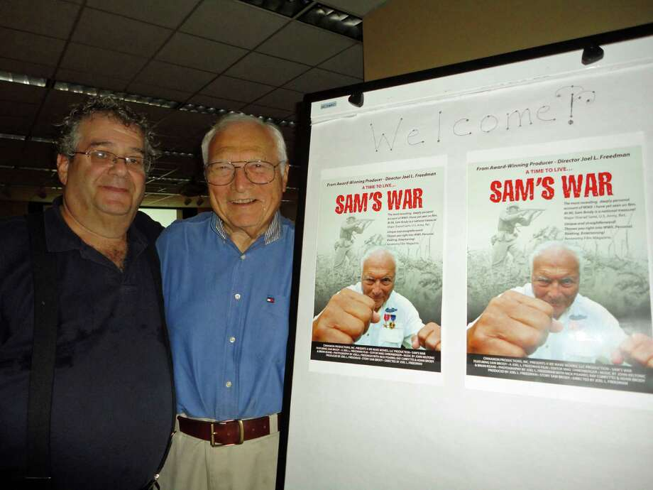 Filmmaker Joel Freedman with Norwalker Sam Brody during a recent screening of ìSamís War: A GIís Journey. î The film is a revealing personal account of Brodyís multiple death-defying wartime experiences as an American Jew from Brooklyn fighting against Nazi Germany. Photo: Meg Barone