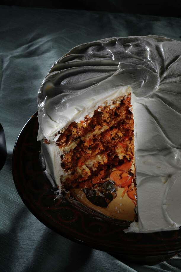 Ruth Fantasia has been working on the perfect carrot cake,  seen here in the Times Union photography studio, on Thursday Oct. 4, 2012 in Colonie, NY.  (Philip Kamrass /  Times Union) Photo: Philip Kamrass / 00019488A