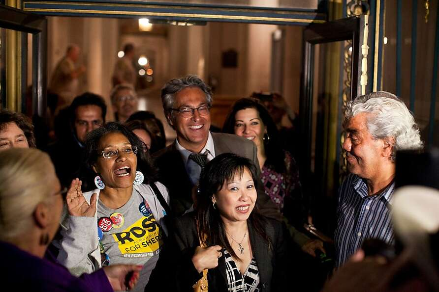 Sheriff Ross Mirkarimi and supporters exit City Hall to cheers after the Board of Supervisors voted