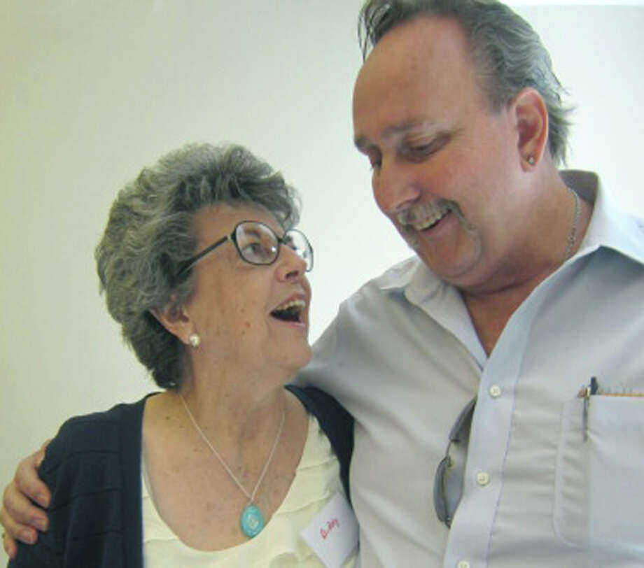 """Sherman """"Doc"""" Chase of New Milford was among the many on hand Sept. 23 for the anniversary celebration of the Loaves & Fishes Hospitality House. Here he reunites with Biddy Roger, who teamed with her husband, John, to run the facility for 28 years. Photo: Norm Cummings"""