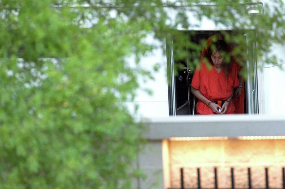 Viktoria Klebanova is transported to the Bob Casey Federal Courthouse Friday, Oct. 5, 2012, in Houston. 