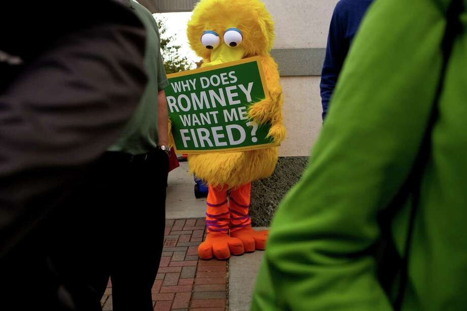 Defenders of Big Bird emerged after Mitt Romney threatened to cut funding for PBS, but one  reader  says the federal government should not subsidize the television network. Another supports PBS funding. Photo: Josh Haner, New York Times / NYTNS