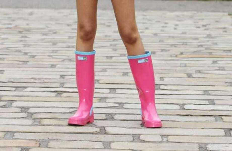 """12. Colorful rain boots:Take a walk through the University of Washington campus any time during the school year and you'll see armies of colorful rain boots stomping by. It's like every sorority member in Seattle is saying, """"Take that, rain. I can still look adorable."""") (Getty Images)"""