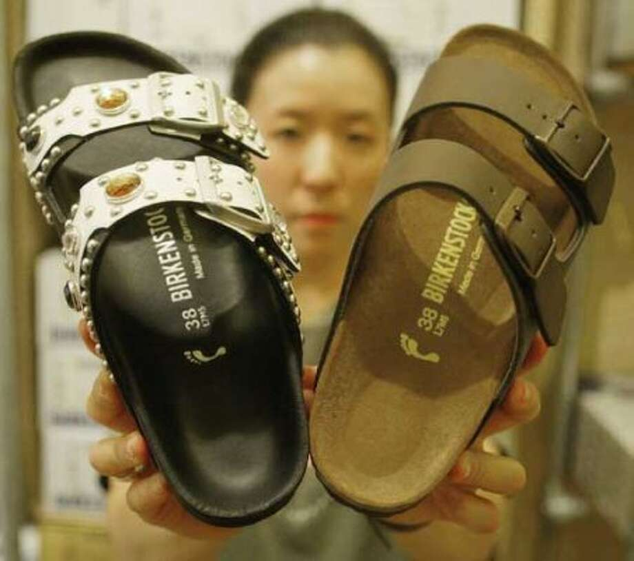 9. Birkenstocks:These sturdy sandals are another myth; we don't wear these much anymore. (Olympia is the exception.) But we do wear... (Getty Images)