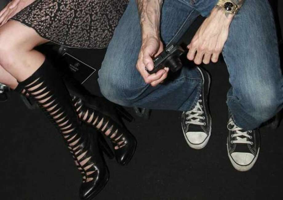 7. Jeans:I know, I know. Jeans aren't exclusive to Seattle. But here, they really are everywhere. At the theater. At weddings. At formal functions. A black-tie dress code might get you a shirt with buttons. Might. (Getty Images)