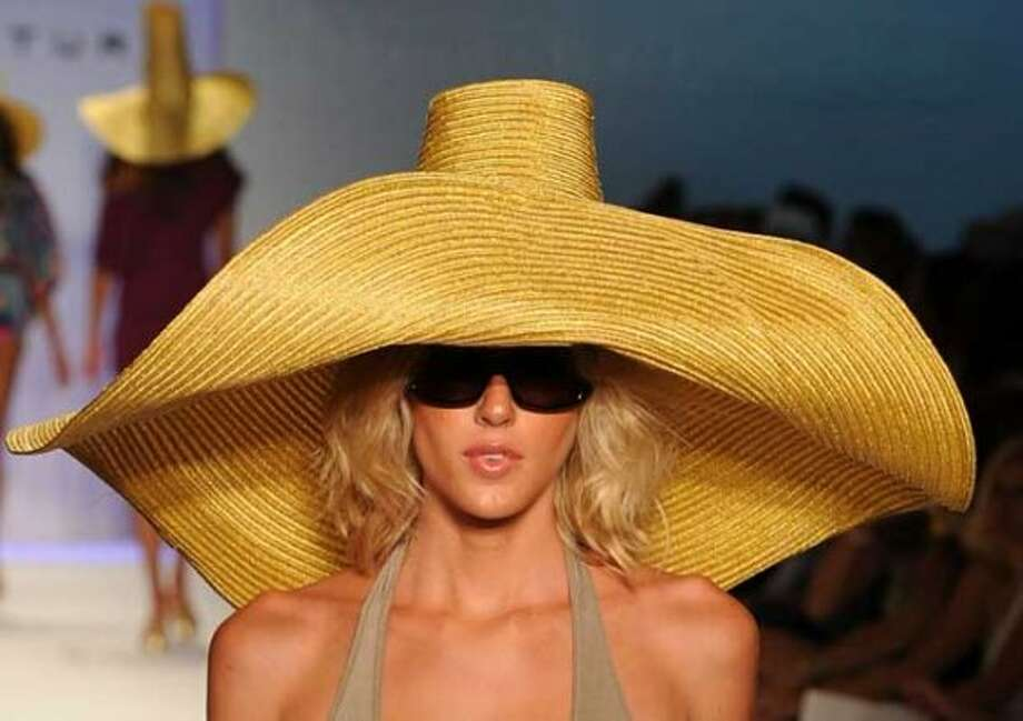6. Sunhats: The sun is out! My head needs a portable house to hide in! Enough said. (Getty Images)