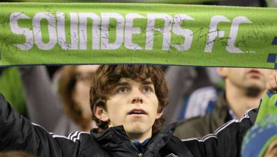 3. Sounders scarves: Sounders fans wear their hearts around their necks, just so everyone on the bus knows they're practically European. Next item on the to-do list: Acquire an exotic accent. (Getty Images)