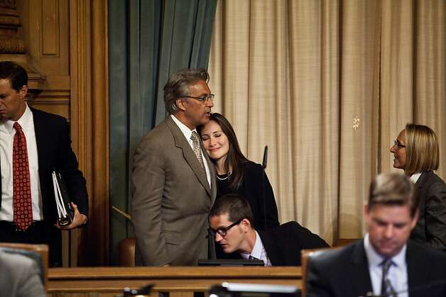 Ross Mirkarimi and Eliana Lopez embrace at the supervisors' proceedings that gave him back his job as sheriff. Photo: Jason Henry, Special To The Chronicle