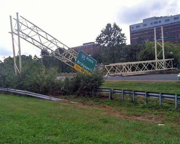 A dump truck struck a sign on Route 7 in Norwalk, Conn., knocking it down onto the highway on Wednesday, Oct. 10, 2012. WTNH ReportIt photo by Tracey. Photo: Contributed Photo