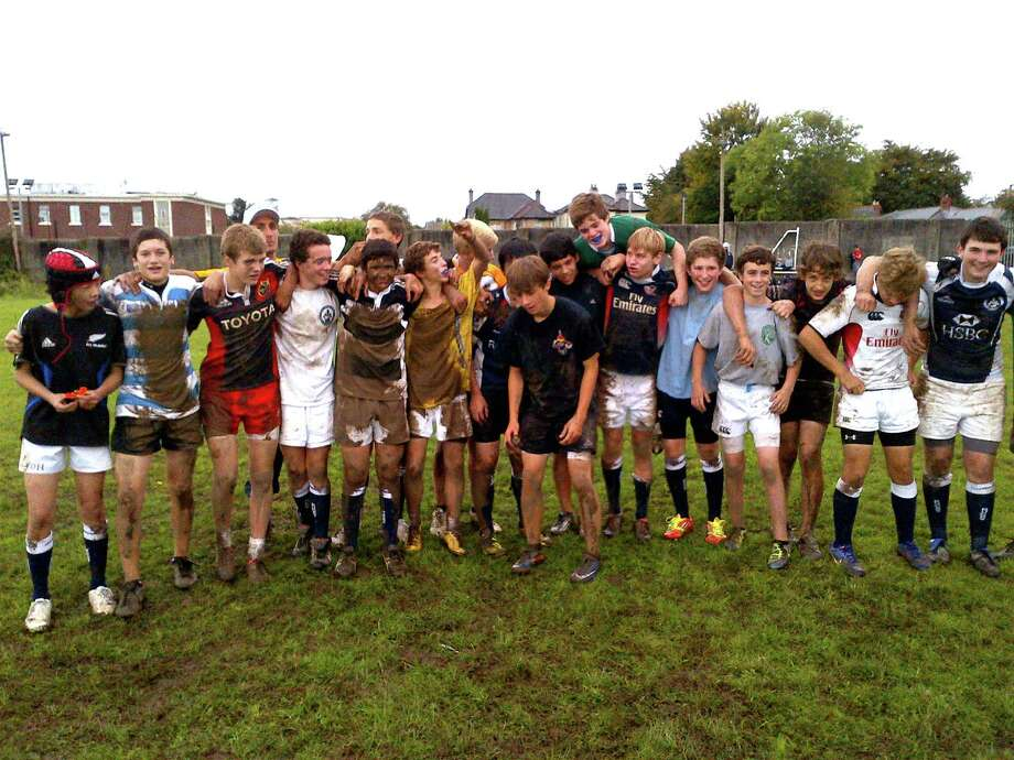 The OGRCC U-15 rugby squad is covered in Irish mud after a practice during their recent trip to Ireland. The team went 2-0 on the trip. Photo: Contributed Photo