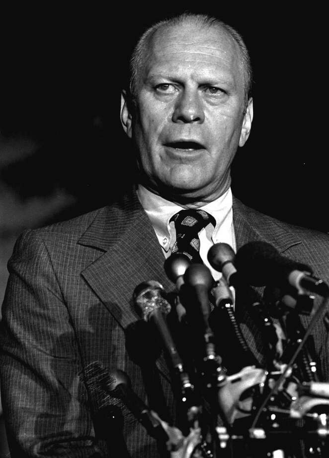 "Gerald Ford used a Bible held by his wife, open to Proverbs 3:5-6. ""Trust in the Lord with all your heart, And lean not on your own understanding; In all your ways acknowledge Him, and He shall direct your paths."" Photo: AP File"