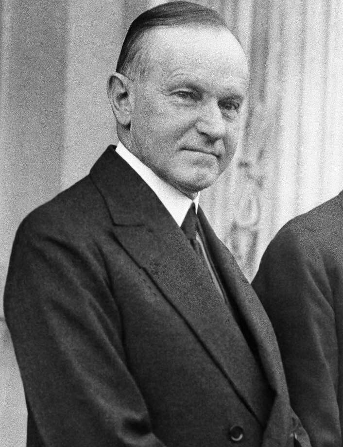 "Calvin Coolidge used a family Bible during both inaugurations in 1923 and 1925. In 1925, it was open to John 1. ""In the beginning was the Word, and the Word was with God, and the Word was God."" Photo: AP File"