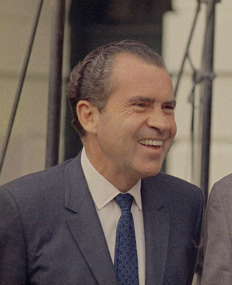 "Richard Nixon used the same two family Bibles at both of his inaugurations. In 1965 and 1969, both bibles were open to Isaiah 2:4. ""He shall judge between the nations, And rebuke many people; They shall beat their swords into plowshares, And their spears into pruning hooks; Nation shall not lift up a sword against nation, Neither shall they learn war anymore."" Photo: Charles Tasnadi, Charles Tasnadi/AP"