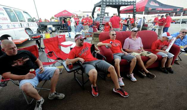 Lamar fans hang out on a couch watching football while tailgating before the homecoming game against Central Arkansas at Lamar in Beaumont, Saturday, October 22, 2011. Tammy McKinley/The Enterprise Photo: TAMMY MCKINLEY