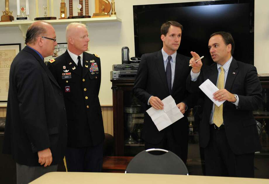 From left: Eugene Brickman, deputy chief of the U.S. Army Corps of Engineers' planning division; Col. Paul E. Owen, commander of the Army Corps' New York district; U.S. Rep. Jim Himes, D-Conn.; and First Selectman Peter Tesei at the ceremony to sign an agreement to conduct a feasibility study of flood-mitigation options for the Byram River watershed at the Glenville fire station Wednesday, Oct. 10, 2012. Photo: Helen Neafsey / Greenwich Time