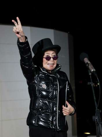 Yoko Ono, widow of the late John Lennon,  invites people from all over the world to join her in spirit when she lights the Imagine Peace Tower on the island of Viðey, near Reykjavik, Iceland, Tuesday, Oct. 9 2012, in honour of all the activists of the world: past, present and future.  The  Imagine Peace Tower  is a beacon of world peace and is the work of the legendary artist, musician and peace advocate Yoko Ono who dedicated it to the memory of her late husband John Lennon. Photo: AP