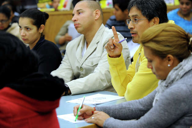 Gonzalo Quilambaqui, second from right, poses a question during an informational meeting for parents of English language learners at Danbury High School, Tuesday, Oct. 9, 2012. Photo: Carol Kaliff / The News-Times