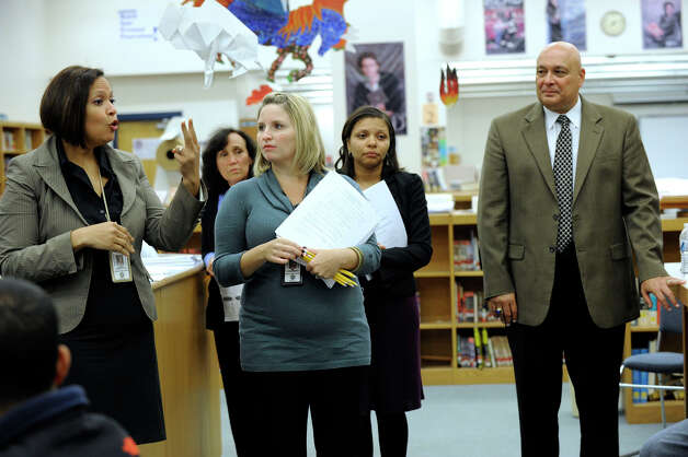 Julie Jiminez, left, speaks to parents of ELS students at an informational meeting Tuesday, Oct. 9, 2012 at Danbury High School. Also from left are Heather Pellicone, ESL department head, Jacqueline Rodriguez, guidance counselor and Gary Boccacio, principal. Photo: Carol Kaliff