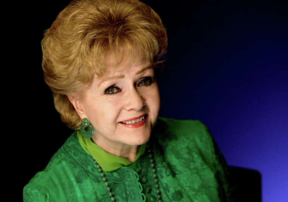 FILE - This Oct. 14, 2011 file photo shows actress Debbie Reynolds posing for a portrait in New York.  Reynolds publicist said Wednesday Oct. 10, 2012 that the actress-singer had to be hospitalized for an adverse reaction to a medication and was canceling several upcoming performances.(AP Photo/Richard Drew, file) Photo: Richard Drew