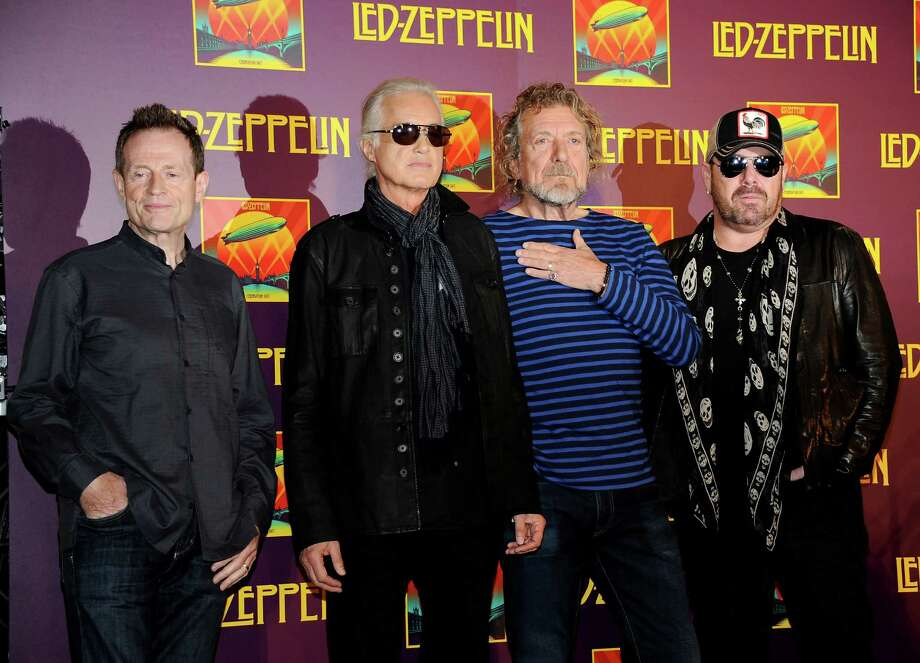 "Led Zeppelin, from left, bassist/keyboardist John Paul Jones, guitarist Jimmy Page, singer Robert Plant, and drummer Jason Bonham participate in a press conference ahead of the worldwide theatrical release of ""Celebration Day"", a concert film of their 2007 London O2 arena reunion show, at the Museum of Modern Art on Tuesday, Oct. 9, 2012 in New York. (Photo by Evan Agostini/Invision/AP) Photo: Evan Agostini"