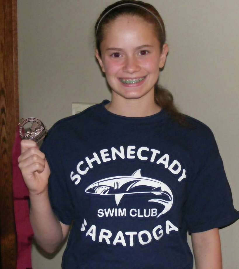 Bailey Smith, 12, a swimmer for the Schenectady Saratoga Sharks Swim Club, broke a regional swimming record in the 200-meter butterfly at the Adirondack championship meet at Colgate University.