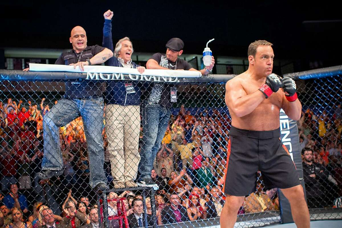 Niko (Bas Rutten), Marty (Henry Winkler) and Mark Dellagrotte cheer on Scott Voss (Kevin James) in Columbia Pictures' HERE COMES THE BOOM.