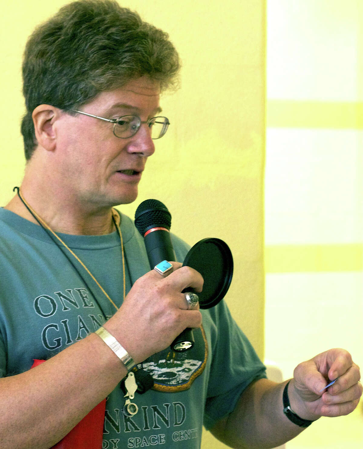 """Dan """"Mac"""" McAuliffe of Brewster, N.Y. reads the winning number for the hourly raffle during during the Danbury Mineralogical Society's annual jewelry, gem and mineral show at New Milford High School. Sept. 8, 2012"""