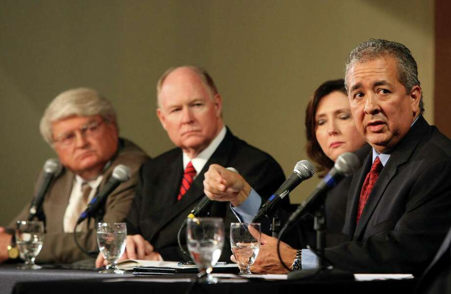 SAWS President and CEO Robert Puente right along with Suzanne Scott, Reed Williams and Calvin Finch discuss San Antonio's future water supply at the third Water Forum at the Pearl Stables on Wednesday Oct. 10, 2012. Photo: Helen L. Montoya, San Antonio Express-News / ©SAN ANTONIO EXPRESS-NEWS