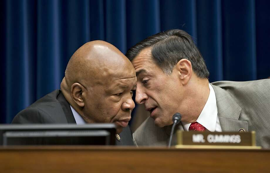 House Oversight Committee leaders Democrat Elijah Cummings (left) and Republican Darrell Issa confer. Photo: J. Scott Applewhite, Associated Press