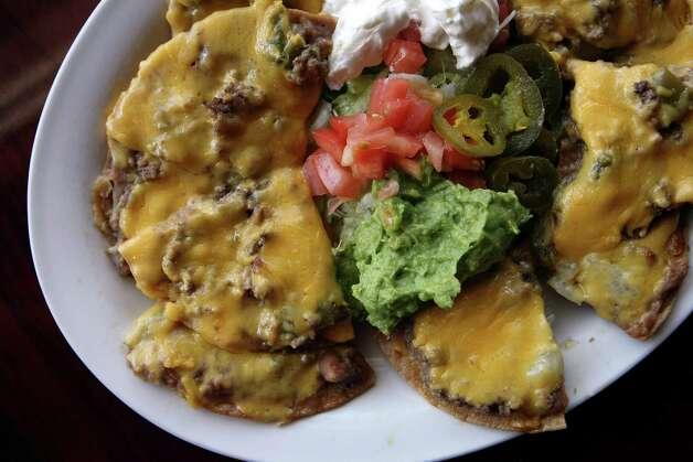 Deluxe nachos (with picadillo) from Thousand Oaks Cafe on Jones-Maltsberger, photographed Monday Oct. 8, 2012. Photo: Helen L. Montoya, SAN ANTONIO EXPRESS-NEWS / SAN ANTONIO EXPRESS-NEWS