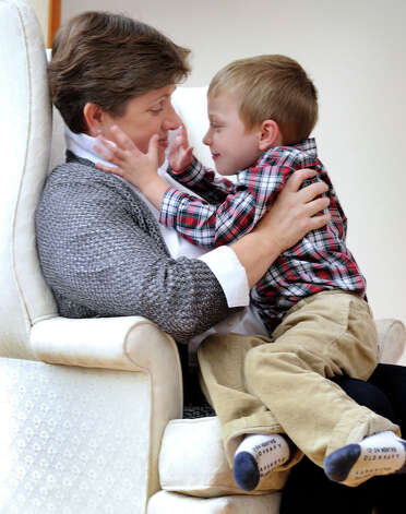 "Marie Hatcher spends time with her son Matthew, 4. Hatcher, 45, of Sherman is a recipient of  the ""Heart of Women"" Award from the Women's Business Council of the Greater Danbury Chamber of Commerce for 2012. Photo: Carol Kaliff / The News-Times"