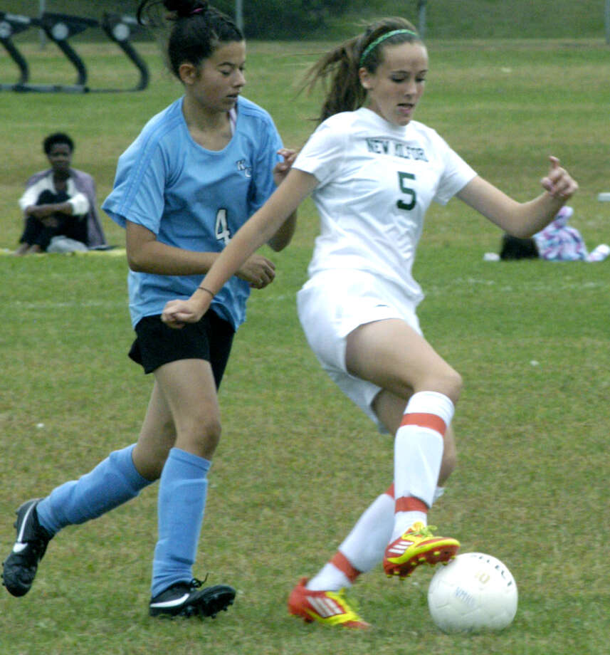 The Green Wave's Rachel Weir demonstrates her foot skills to a rival during New Milford High School girls' soccer's Sept. 22, 2012 match vs. Kolbe Cathedral at NMHS. Photo: Norm Cummings