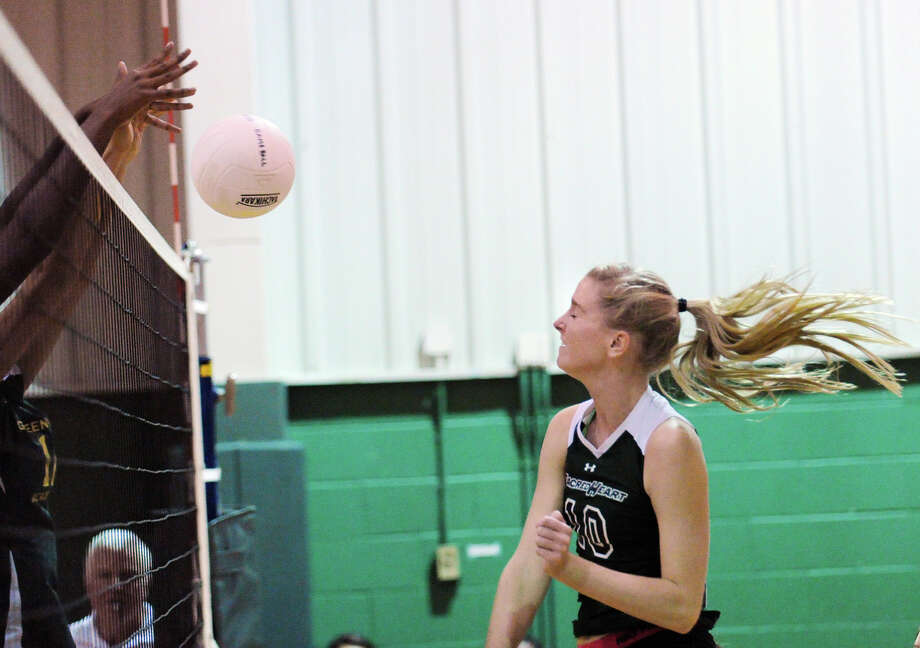 At right, Devon Hoffman of Convent of the Sacred Heart gets her spike blocked by Kayla Johnson, left, of Greenwich Academy, during the girls high school volleyball match between Greenwich Academy and Convent of the Sacred Heart Wednesday afternoon at Convent of the Sacred Heart in Greenwich, Oct. 10, 2012. Photo: Bob Luckey / Greenwich Time