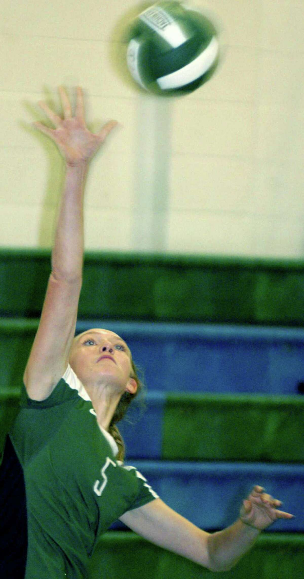 The Green Wave's Stephanie Fleet demonstrates the serving technique that accounted for 18 straight points during Game 1 of New Milford High School volleyball's victory over visiting Notre Dame of Fairfield, Oct. 5, 2012