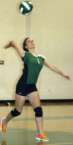 Juliana Fusco of the Green Wave winds for a serve during New Milford High School volleyball's victory over visiting Notre Dame of Fairfield, Oct. 5, 2012 Photo: Norm Cummings