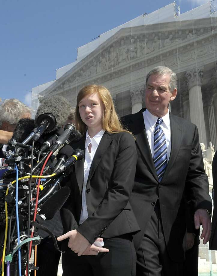 Abigail Fisher, the Texan involved in the University of Texas affirmative action case, accompanied by her attorney Bert Rein, talks to reporters outside the Supreme Court in Washington, Wednesday, Oct. 10, 2012. The Supreme Court is taking up a challenge to a University of Texas program that considers race in some college admissions. The case could produce new limits on affirmative action at universities, or roll it back entirely. The University of Texas at Austin President Bill Powers is at right. (AP Photo/Susan Walsh) Photo: Susan Walsh, Associated Press