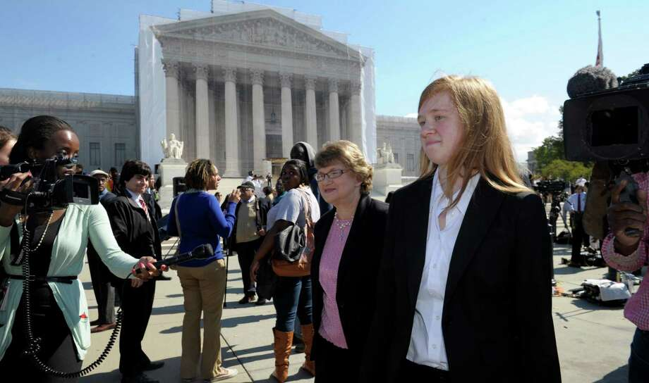 Abigail Fisher, the Texan involved in the University of Texas affirmative action case, walks outside the Supreme Court in Washington, Wednesday, Oct. 10, 2012. The Supreme Court is taking up a challenge to a University of Texas program that considers race in some college admissions. The case could produce new limits on affirmative action at universities, or roll it back entirely. (AP Photo/Susan Walsh) Photo: Susan Walsh, Associated Press / AP