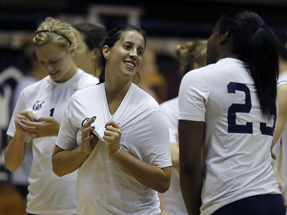 Joan Caloiaro (center), a cousin of Olympics star Kerri Walsh Jennings, is Cal's setter this season. Photo: Paul Chinn, The Chronicle