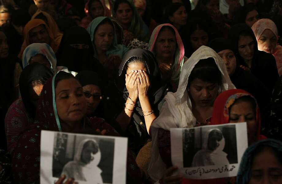 The Taliban tries to assassinate a schoolgirl: In Karachi, supporters of Pakistan's Muttahida Qaumi Movement chant prayers for 14-year-old Malala Yousufzai, who was gunned down by the Taliban for speaking out in support of education for girls. Doctors successfully removed a bullet from her neck, but she remained in critical condition. Photo: Shakil Adil, Associated Press
