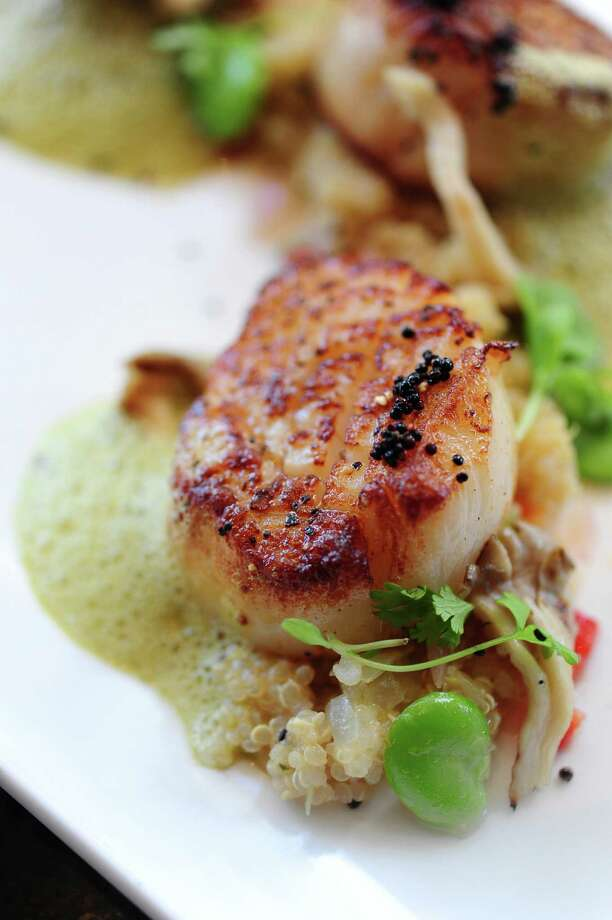Scallops with Peruvian quinoa, chupe emulsion, oyster mushrooms, fava bean vinaigrette and fried black quinoa. Photo: Debora Smail / Debora Smail