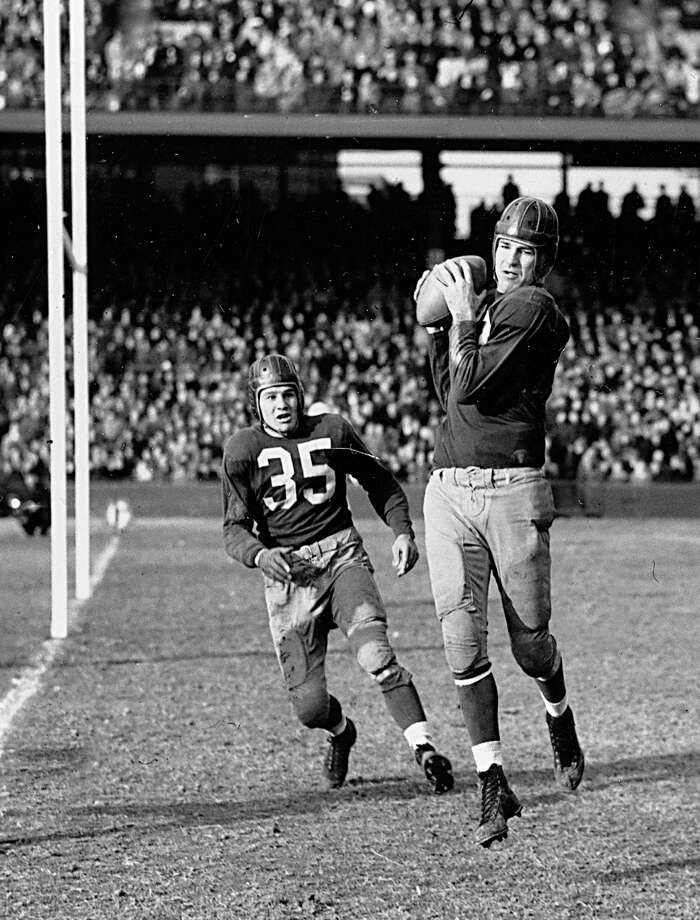 ** FILE ** In this Dec. 13, 1942 file photo, Sammy Baugh, quarterback for the Washington Redskins, intercepts a pass from the Chicago Bears in his own end zone to break up a Bears scoring threat during the fourth quarter of NFL Playoff Championship game in Washington. Chicago Bears tackle in background is Lee Artoe (35). Baugh, who set numerous passing records with the Washington Redskins in an era when NFL teams were running most every down, died Wednesday night, Dec. 17, 2008 his son said.  Baugh, who was 94 and had numerous health issues, died at Fisher County Hospital in Rotan, Texas, David Baugh said. (AP Photo) / AP