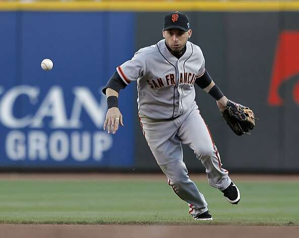 Giants second baseman Marco Scutaro has trouble handling a hit by the Reds Mike Leake in the fourth inning, as the San Francisco Giants  take on the Cincinnati Reds in game four of the National League Division Series in Cincinnati, Ohio on Wednesday Oct. 10, 2012. Photo: Michael Macor, The Chronicle