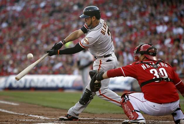 Giants' Gregor Blanco hits a two run home run in the second inning, as the San Francisco Giants take the lead on the Cincinnati Reds 2-1, in game four of the National League Division Series in Cincinnati, Ohio on Wednesday Oct. 10, 2012. Photo: Michael Macor, The Chronicle